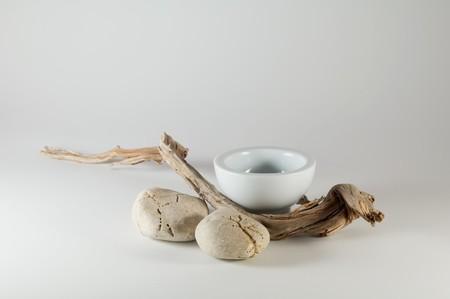 Wabi Sabi - Zen elements: white bowl, stones and wooden branch