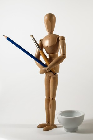Painter manikin with brush and pencil - Artist concept photo