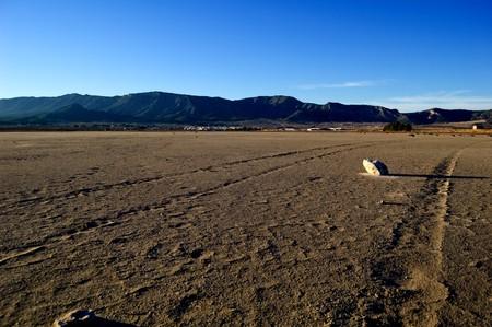 Climate change: dry salt lake - desert landscape, tire track detail - Laguna de Salinas (Spain) photo