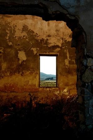 abandoned factory: abandoned factory - room with window - spanish landscape Stock Photo