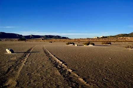 Dry salt lake, climate change: global warming - desert landscape, tire track detail - Laguna de Salinas (Spain) photo