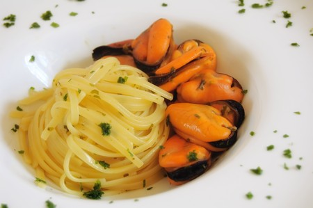 Pasta with mussels on white dish - Italian food Stock Photo - 4410611