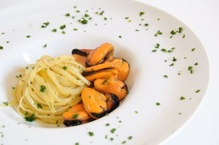 Pasta with mussels on white dish - Italian food Stock Photo - 4485161