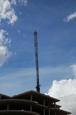 Building under construction, concrete structure and crane silhouette Stock Photo - 4730376