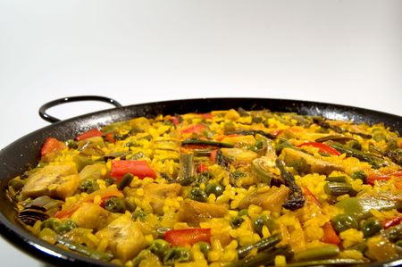 Traditional Spanish rice: Paella and vegetables - Vegetarian recipe photo