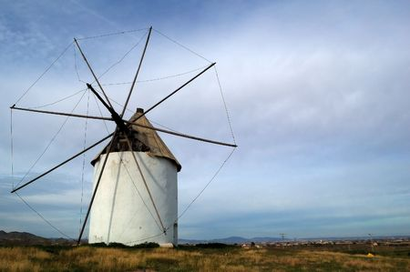 Typical spanish windmill in a meadow, rural landscape