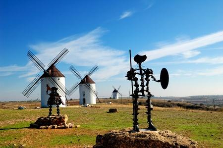 don quixote: Spain, windmills and Don Quixote statue in Mota del Cuervo Stock Photo