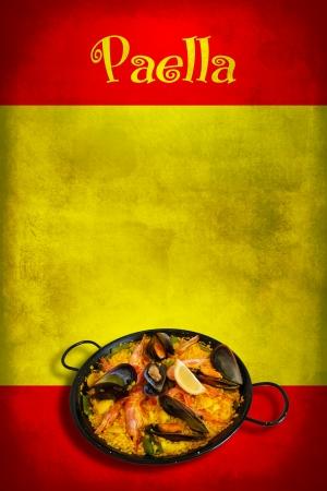 spanish culture: Traditional spanish dish: paella valenciana on spanish flag