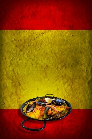 Traditional spanish dish: paella valenciana on spanish flag