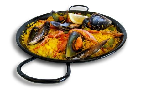 Paella with seafood, Spanish plate in the traditional pan photo