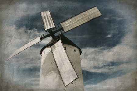 España, molino de viento estilo vieja foto en fondo del grunge
