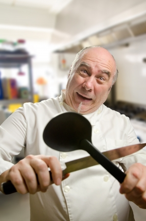sharpening: Crazy cook with a spoon and a knife Stock Photo