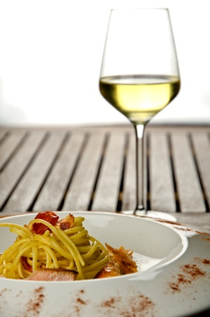 Linguine with fresh salmon, italian pasta plate on wooden table photo