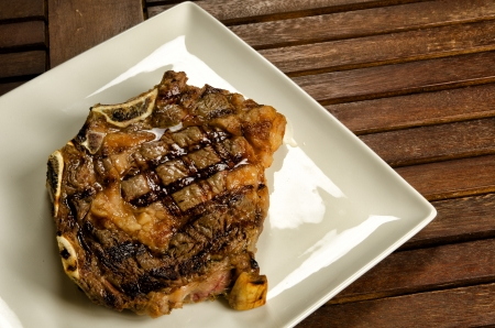 Grilled sirloin beef steak on white plate photo