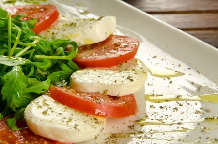 italy background: Caprese salad, italian appetizer with mozzarella and tomatoes