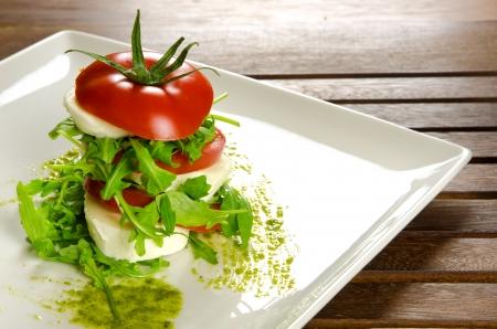 caprese salad: Caprese salad, italian appetizer with mozzarella and tomatoes
