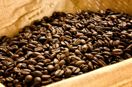 stimulant: Roasted coffee beans in a basket with rustic canvas Stock Photo