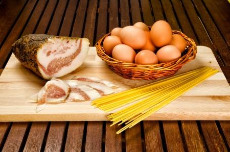 Spaghetti carbonara ingredients, bacon, eggs, pasta Stock Photo - 16780789