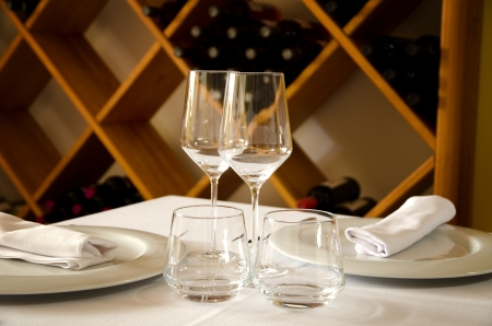 Restaurant table with dish, glasses and cutlery photo