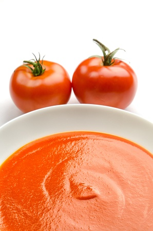 Tomato soup in a white plate photo