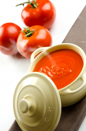 Tomato soup in a casserole and ingredients photo