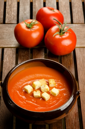 Tomato soup in a earthenware bowl with tomatoes Stock Photo - 17211583