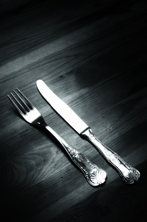 Old silver cutlery on wooden background, vintage image photo