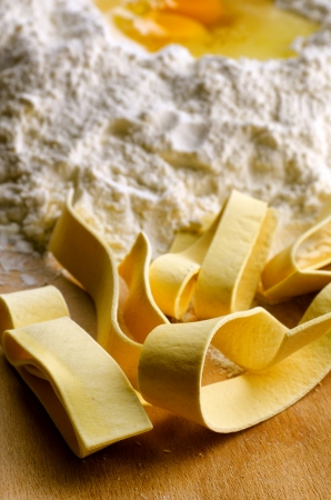 Homemade fresh pasta, italian pappardelle with ingredients photo