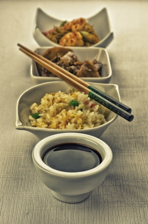 chinese noodles: Chinese food composition with cantonese rice, noodles with prawns and beef with mushrooms Stock Photo