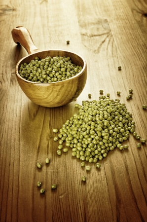 Green soybeans on wooden background, biologic agriculture photo