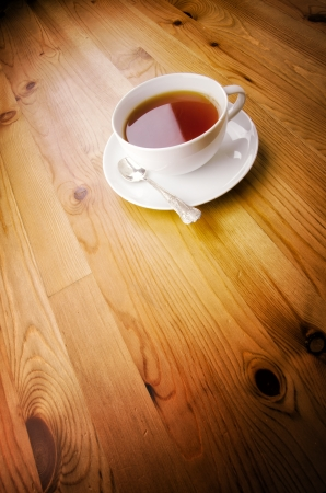 Cup of tea on wooden background with copy space photo