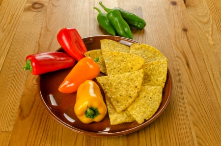 Raw Mexican food, nachos and colorful peppers photo
