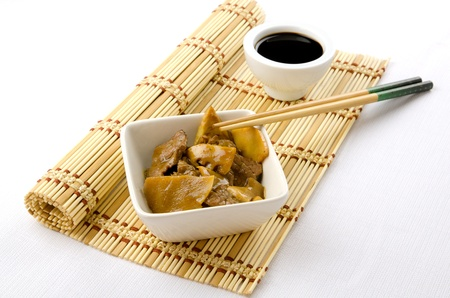 Beef with bamboo and shitake, chinese mushrooms, traditional chinese dish photo