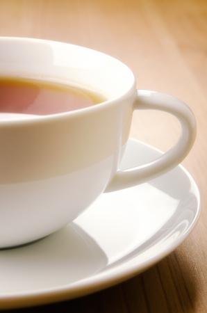 herbolaria: Taza de té en el fondo de madera, detalle Foto de archivo
