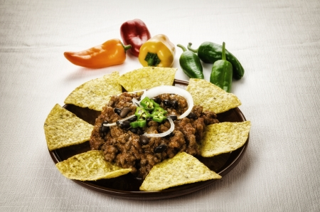 Mexican food: chili with meat served with nachos photo