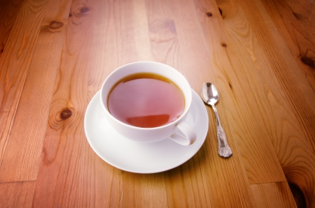 Cup of tea on wooden background photo