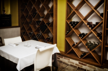 Restaurant table with wine bottles