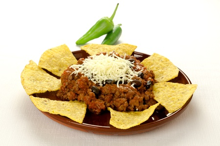 Mexican food  cheesy chili with meat served with nachos photo