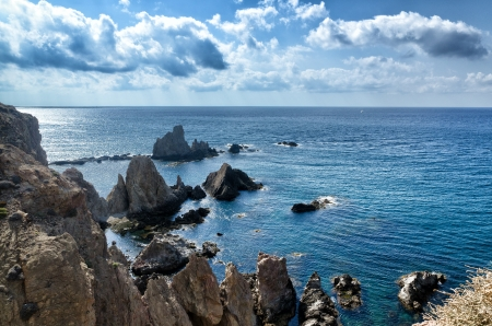 sirens: Sirens reef at Cabo de Gata, Spain  Seascape with reef and clouds