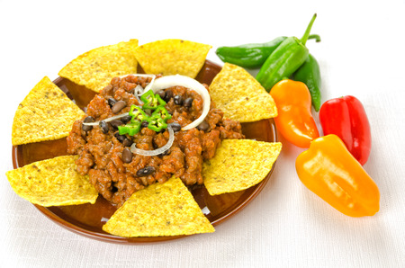Mexican food  chili with meat served with nachos photo