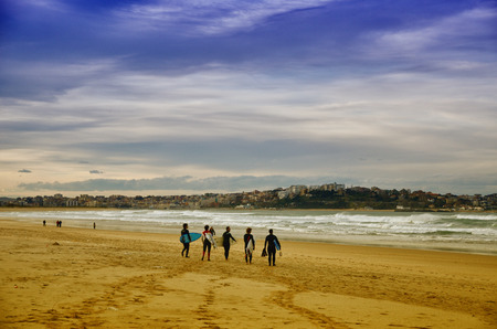 santander: Young surfers on the beach at Somo Surfer center, Cantabria, Spain