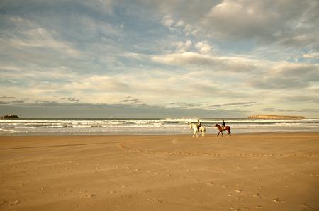 Riding horses on the beach, Somo beach, Santander, Spain photo