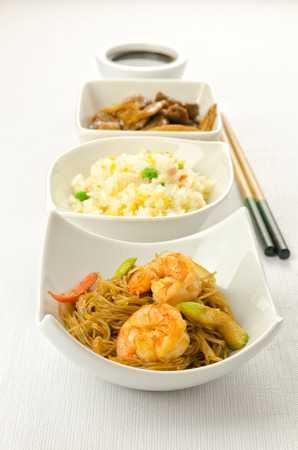 Chinese food dishesm cantonese rice, noodles, beef with bamboo photo