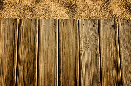 beach bar: Wooden boards and sand, background