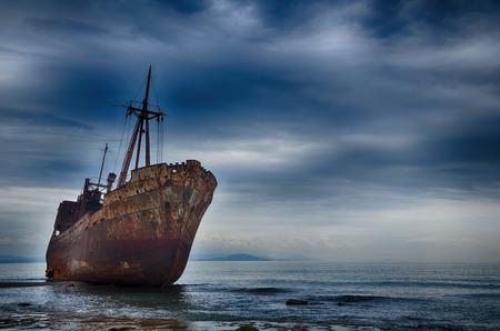 outcast: Abandoned ship on the beach, failure concept
