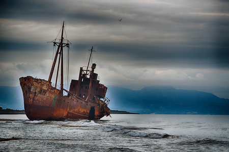 abandoned: Abandoned ship on the beach, failure concept