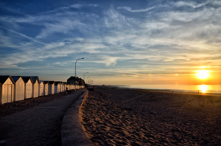 sea beach: Sunset at the beach in Normandy with bathing hut Stock Photo