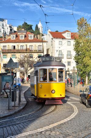 parole: Lisbon, Portugal. Classical yellow tram in the dowtown. Portuguese destination