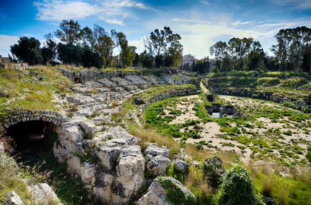 archaeologist: Archaeological Park of Neapolis in Syracuse, Sicily, ruins of the Roman amphitheater