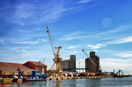 Port activities, commercial and maintenance in a cargo port. Stock Photo